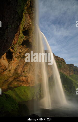 Seljalandsfoss waterfall plunging 60m from the cliff above, Sudhurland, Iceland - Stock Photo