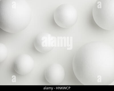 upper view of white spheres on a white background - Stock Photo