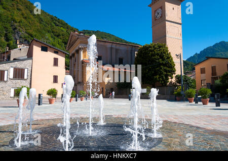 Water fountain in Porlezza, Lake Lugano in the Province of Como in the Italian region Lombardy, Italy - Stock Photo