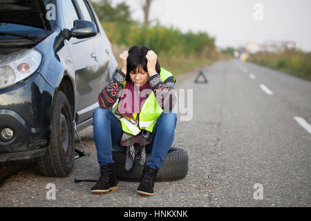 Woman car broke down on the empty road, Selective focus and small depth of field - Stock Photo