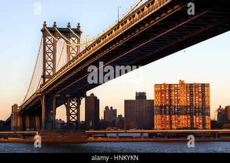 Manhattan Bridge taken from Brooklyn looking across towards Manhattan in the early evening at sunset - Stock Photo