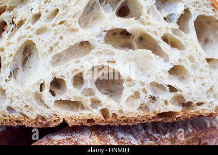 Cut artisan bread loaf in detail - Stock Photo