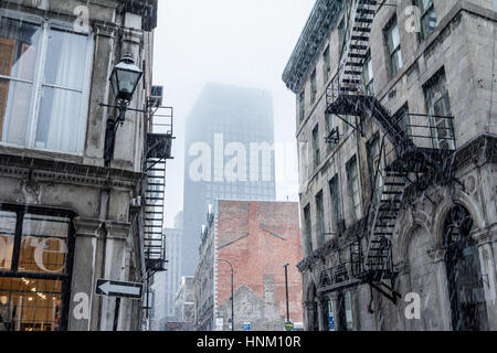Street in Old-Montreal in winter under the snow. Montreal is the capital city of Quebec, in Canada  Old Montreal - Stock Photo