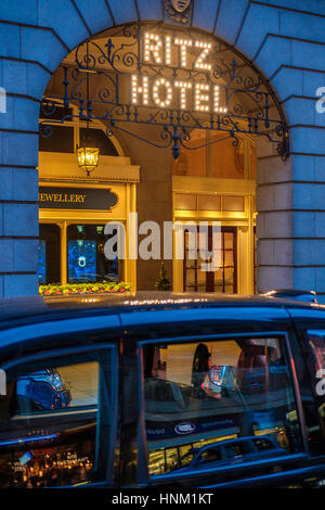 London Cab at The Ritz Hotel at Night,Piccadilly,London,England - Stock Photo