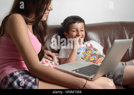 Children watching funny videos - Stock Photo