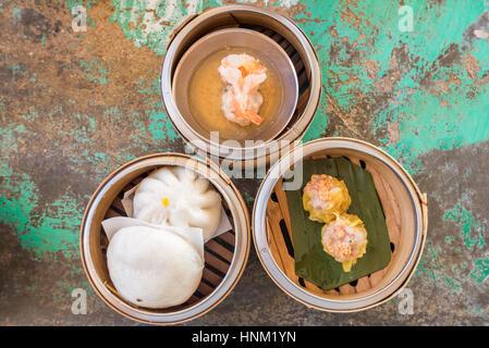 Chinese Dim sum in bamboo basket - Stock Photo