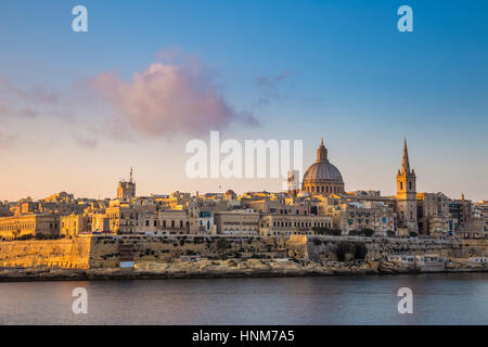 Valletta, Malta - St.Paul's Cathedral and the ancient city of Valletta at sunrise - Stock Photo