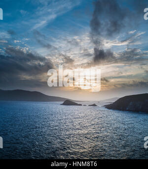 Looking westwards at sunset towards the Blasket Islands from Dunquin, Dingle Peninsula, County Kerry, Ireland - Stock Photo