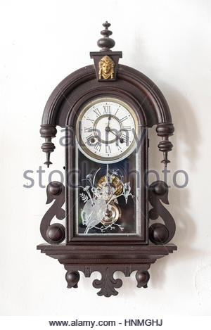 Cuban vintage objects: Old colonial wall clock. The items are preserved in 'La Periquera' building which is a tourist - Stock Photo