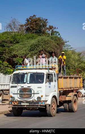Ethiopian Building Workers Being Transported By Lorry, Arba Minch, Ethiopia - Stock Photo