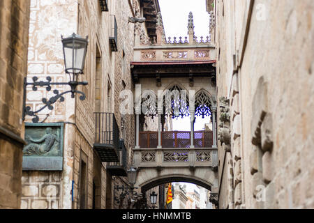 Barcelona's Bridge of Sighs, side facade of the Carrer del Bisbe, Gothic cathedral of La Catedral de la Santa Creu - Stock Photo