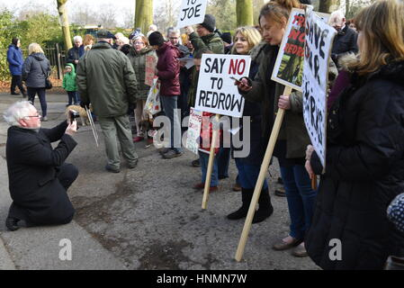 Liverpool, UK. 14th Feb. 2017. Protestors demonstrate at Calderstones Park entrance against the proposed development - Stock Photo