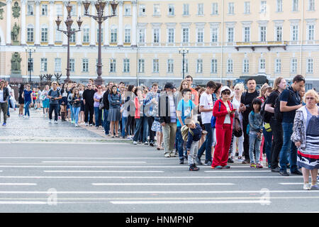 ST. PETERSBURG, RUSSIA - JULY 12, 2016: Tourists stand in queue long hours in the State Hermitage Museum, St. Petersburg, - Stock Photo
