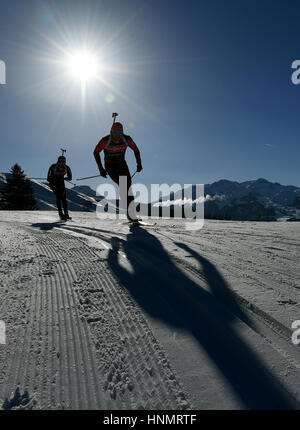 Hochfilzen, Germany. 14th Feb, 2017. Biathletes train along the route during the Biathlon World Championships in - Stock Photo