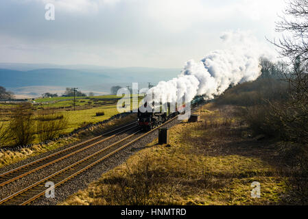 Ribblesdale, North Yorkshire, UK. 14th Feb, 2017. Steam locomotive Tornado hauls a train through Ribblesdale on - Stock Photo