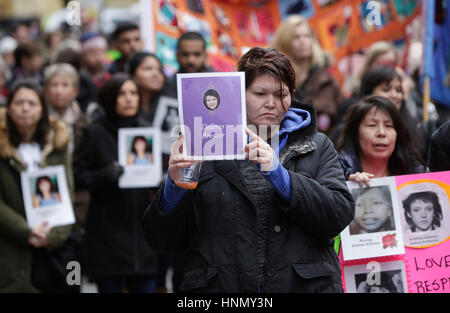 Vancouver. 14th Feb, 2017. People hold photos of female victims during the Women's Memorial March in Vancouver, - Stock Photo