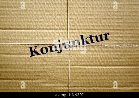 Berlin, Germany. 30th May, 2016. ILLUSTRATION - Image of a bound up package with the word 'Konjunktur' (economic - Stock Photo