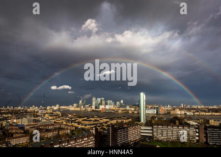 London, UK. 15th Feb, 2017. UK Weather: Massive colourful rainbow breaks over south east London including Canary - Stock Photo