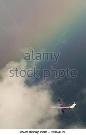 London, UK. 15th Feb, 2017. UK Weather: A Flybe Bombardier Dash-8 plane leaving City Airport approaches a massive - Stock Photo