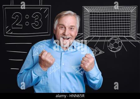 Joyful happy man holding banknotes - Stock Photo