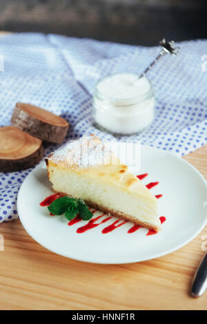 triangle cheese cakes in cafe. On a wooden table - Stock Photo