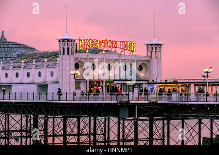 Winter Twilight sunset with a warm reddish tone at Brighton Pier, Brighton, Engalnd, UK - Stock Photo