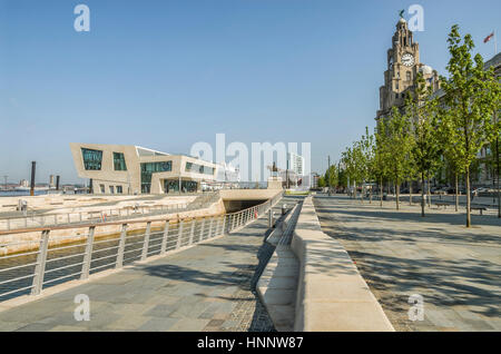 """The new ferry terminal at Pier Head in Liverpool sits in front of the """"Three Graces"""" on a UNESCO World Heritage - Stock Photo"""