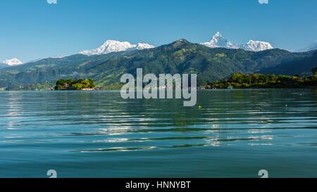 The Machapuchare and Annapurna range seen from Phewa Lake in Pokhara, Nepal - Stock Photo