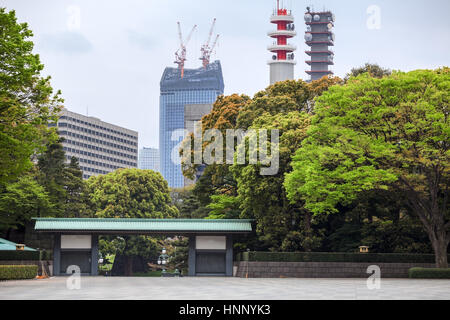 TOKYO, JAPAN - CIRCA APR, 2013: View from Tokyo Imperial Palace area at gate to Nijubashi bridge and Toranomon Hills - Stock Photo
