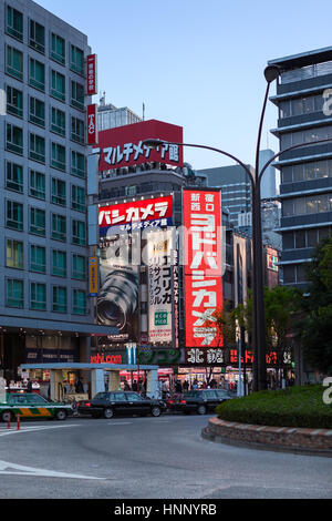 TOKYO, JAPAN - CIRCA APR, 2013: Contemporary illuminated buildings with lot of banners are in the Shinjuku district - Stock Photo