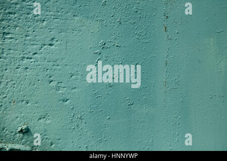 Teal color rough textured painted wall background. Abstract grunge blue uneven surface - Stock Photo