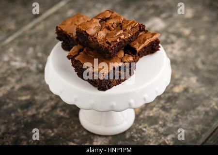 homemade chocolate brownies on a dessert plate - Stock Photo