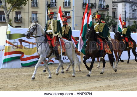 Hussars on horseback perform at a military display in downtown Budapest - Stock Photo