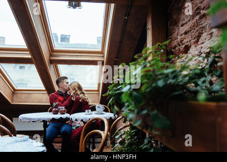 Beautiful young man and woman are celebrating Valentine day - Stock Photo