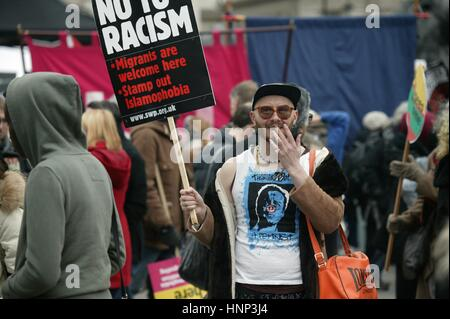 Flamboyant Character with a No To Racism Sign at the Stand Up To Racism Protest in Trafalgar Square in London. - Stock Photo