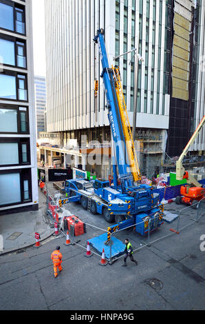 London, England, UK. Sarens Terex AC 100/4L Telescopic crane on a construction site by the Barbican, City of London - Stock Photo