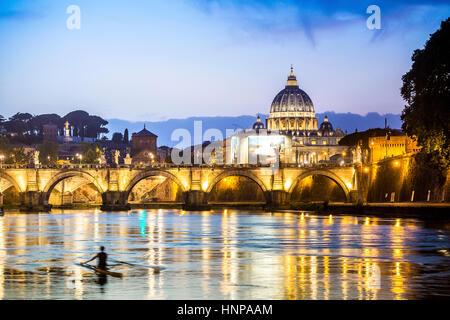 Saint Peter's Basilica with bridge over Tiber, dusk, Vatican City, Rome, Italy - Stock Photo