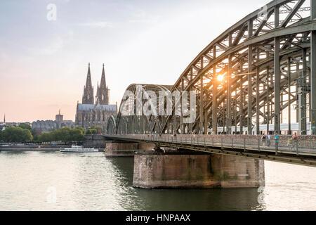 Cathedral and steel bridge, Koln, Germany - Stock Photo