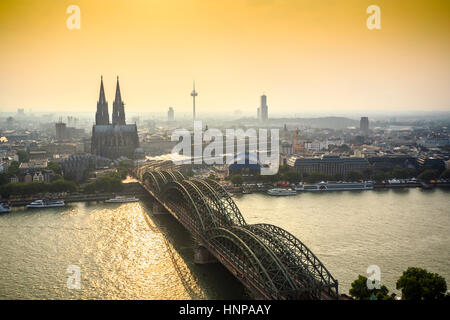 Cityscape with cathedral and steel bridge, Koln, Germany - Stock Photo