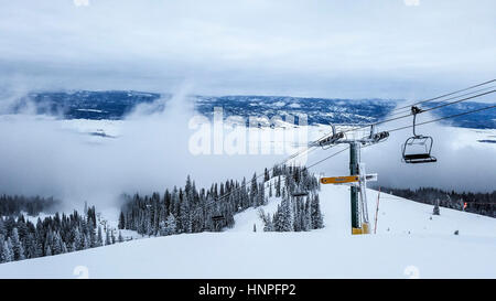 Skiing at Tamarack Resort outside Donnelly near McCall, ID. View from the top of ski lift and snowy landscape. - Stock Photo
