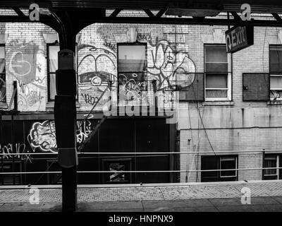 New York Subway System. Graffiti platform in Brooklyn. - Stock Photo