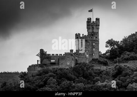 Sooneck Castle at the outermost tip of the Soon Forest above Niederheimbach in cloudy weather on the Rhine River - Stock Photo