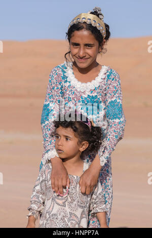 two Bedouin girls in Wahiba Sands, Oman, Middle East, Asia - Stock Photo