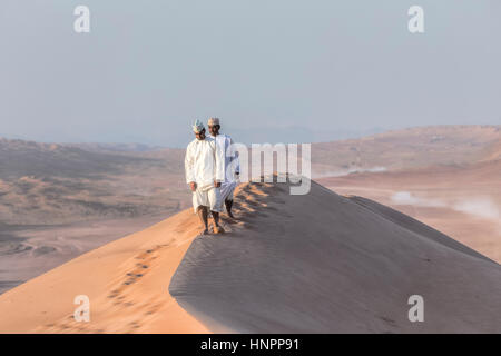 two Omani men in Wahiba Sands, Oman, Middle East, Asia - Stock Photo