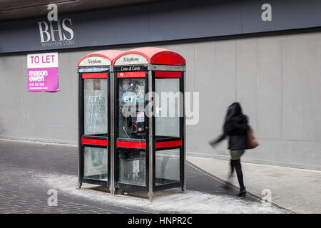 BT KX100 Disused, dirty, redundant red BT Telephone Boxes outside BHS in Liverpool City centre, Merseyside, UK - Stock Photo