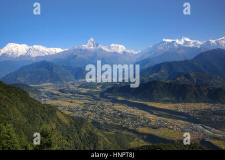 View from Sarangkot towards the Annapurna Conservation Area & the Annapurna range of the Himalayas, Nepal. - Stock Photo