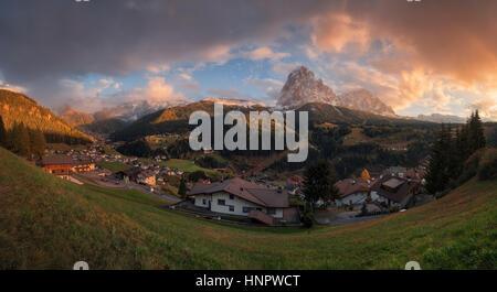 Italy. Dolomites. Panorama of the village of Santa Cristina in Val Gardena and the mountains Sassolungo - Stock Photo