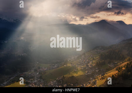 Italy. Dolomites. The slopes of the village of Santa Cristina Val Gardena in evening sunshine - Stock Photo