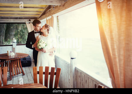 Bride and groom in the cafe an outdoor  - Stock Photo