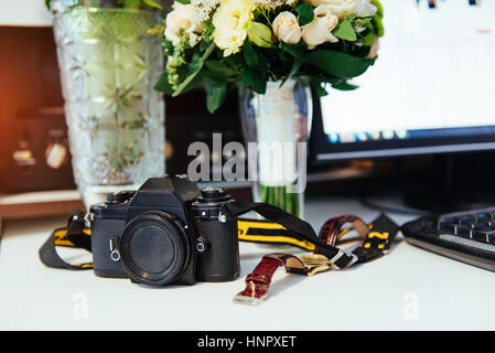 Photo retro camera on a table with different objects - Stock Photo